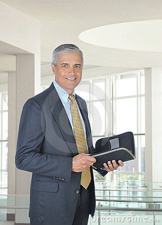 Smiling Middle Aged Businessman with Planner