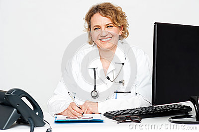 Smiling middle aged female doctor