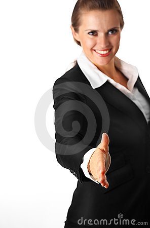 Smiling modern business woman stretches out hand f
