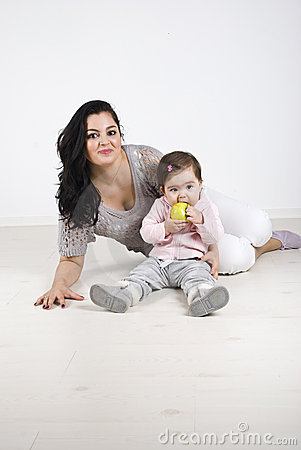 Free Smiling Mother And Baby Girl Sitting On Floor Royalty Free Stock Photography - 14077587