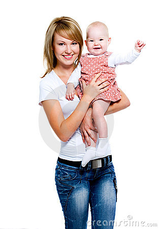 Smiling mother with baby on hands