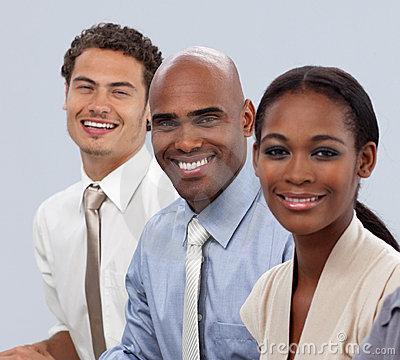 Smiling multi-ethnic business people in a line