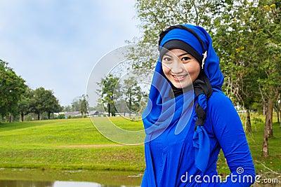Smiling muslim woman.