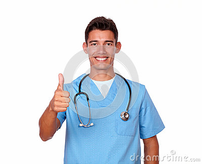 Smiling nurse in uniform gesturing positive sign