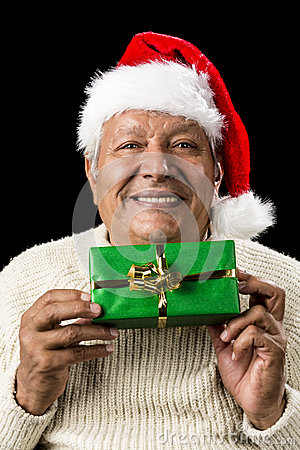 Smiling Old Man Handing Over A Wrapped Green Gift