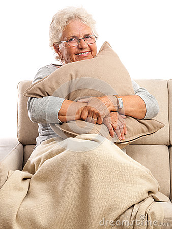 Smiling old woman resting at home.