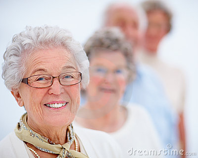 Smiling older woman standing in a line