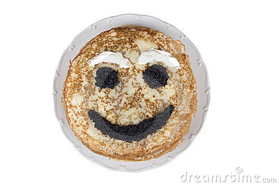 Smiling pancake on a plate