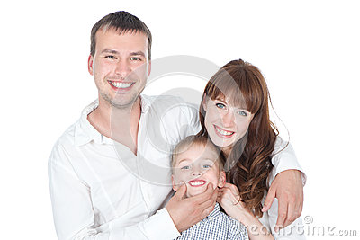 Smiling parents with little son posing on white