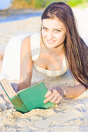 Smiling Person Relaxing With Book