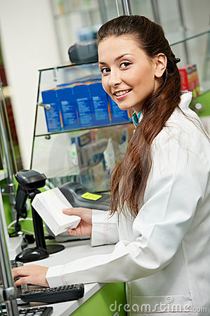 Smiling Pharmacy chemist woman in drugstore