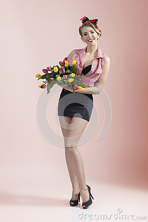 Smiling pin-up with coloured flowers