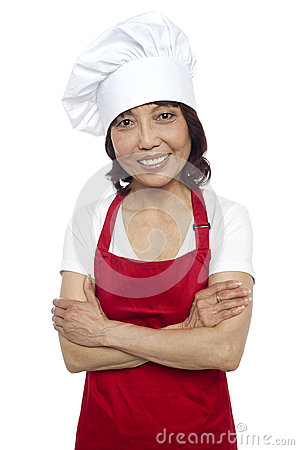 Smiling portrait of confident asian chef