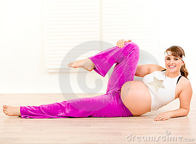 Smiling pregnant woman doing aerobics exercise