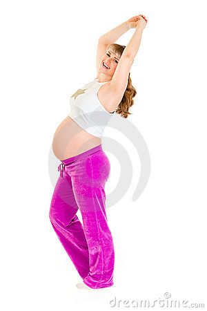 Smiling pregnant woman doing fitness exercises