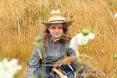 Smiling Preteen country girl with straw hat