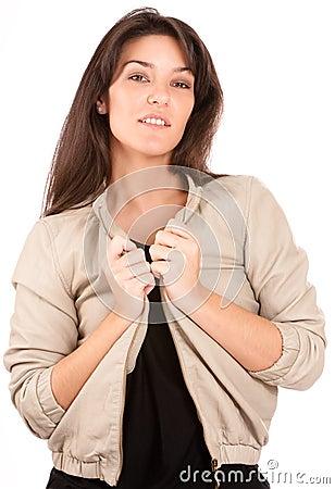 Smiling pretty brunette arranging her jacket