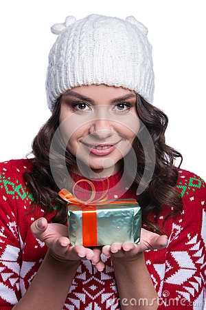 Free Smiling Pretty Sexy Young Woman Wearing Colorful Knitted Sweater With Christmas Ornament And Hat, Holding Christmas Gift. Royalty Free Stock Photo - 81980095