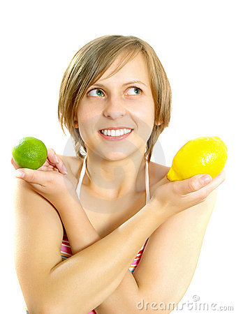 Smiling pretty young lady with lemon and lime