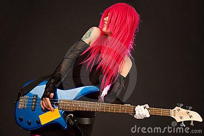 Smiling punk girl with bass guitar