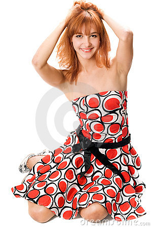 Smiling red-haired girl in a dress