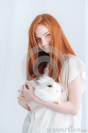 Free Smiling Redhead Woman Holding Rabbit Stock Photo - 71707510