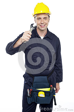 Smiling repairman holding out screwdriver
