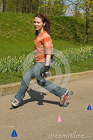 Free Smiling Rollerskating Girl Royalty Free Stock Photos - 5121518