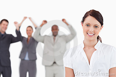 Smiling saleswoman with cheering associates