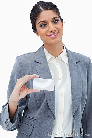 Smiling saleswoman showing her blank business card
