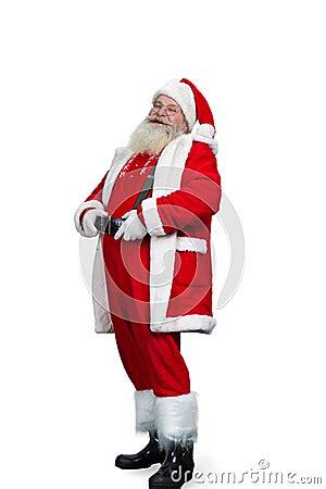 Free Smiling Santa Claus Holding His Belt. Royalty Free Stock Image - 102801976