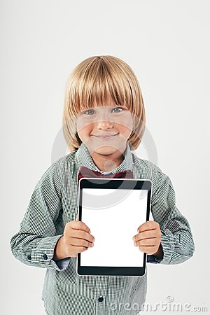 Free Smiling School Boy In Shirt With Red Bow Tie, Holding Tablet Computer In White Background Royalty Free Stock Photo - 110754295