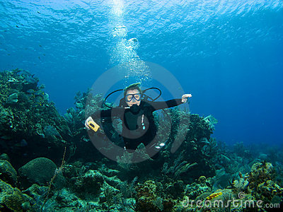 Smiling Scuba Diver descending on a Reef