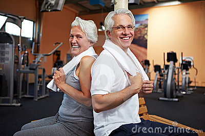 Smiling senior couple in gym