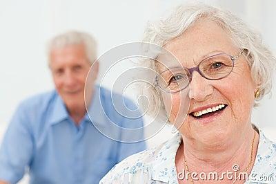 Smiling senior lady with husband