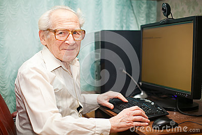 Smiling Senior Man Near Computer