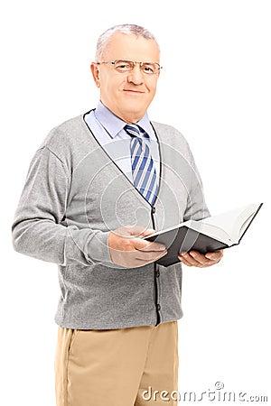 Smiling senior man reading a book