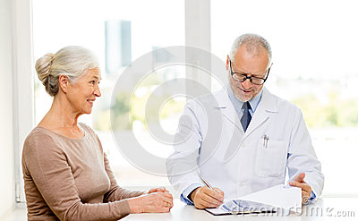 Smiling Senior Woman And Doctor Meeting Stock Photo ...