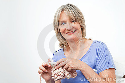 Smiling senior woman knitting