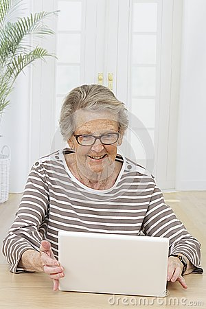 Smiling Senior woman looking at her computer