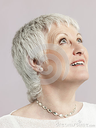 Free Smiling Senior Woman Looking Up Stock Photography - 33907212