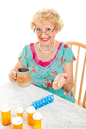 Smiling Senior Woman Takes Medicine