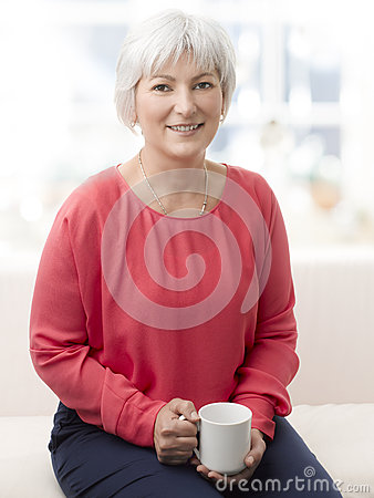 Smiling senior woman with tea