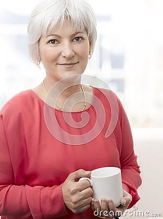 Smiling senior woman with tea