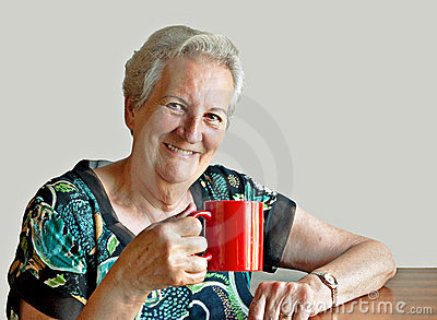 Smiling seventy-something woman with mug