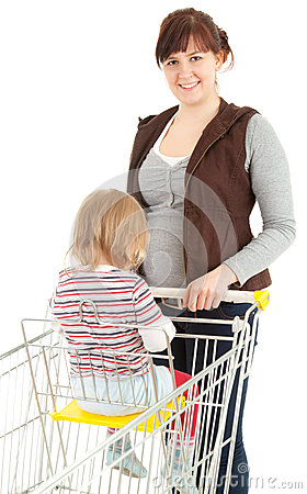 Smiling shopping mother with baby in trolley