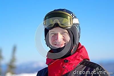 Smiling skier in helmet