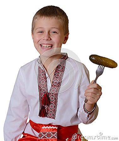 Smiling slavic boy with fork