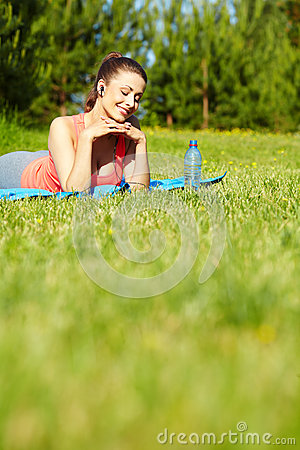 Smiling sport fitness model outside