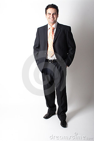 Free Smiling Standing White Businessman In Suit With Hands In Pockets Stock Photography - 718042